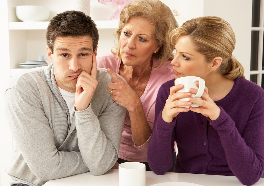Senior Mother Interferring With Couple Having Argument At Home