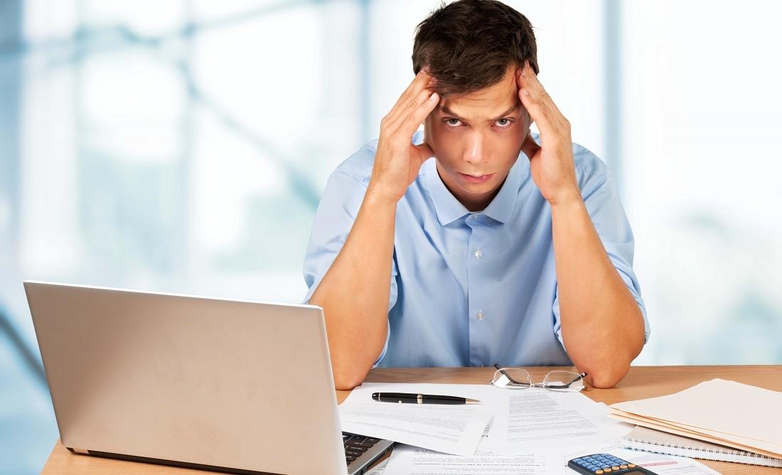 Debt. Man calculating his bills